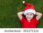 Little Asian Girl In Santa Hat...