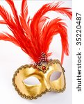 venetian mask with red  plume. | Shutterstock . vector #35220487
