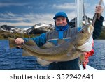 Fisherman With Big Fish On The...