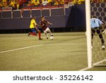EAST RUTHERFORD NJ - AUGUST 12: Luis Seijas #13 of Venezuela handles the ball against Colombia during the International Friendly match at Giants Stadium on August 12 2009 in East Rutherford NJ - stock photo