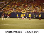EAST RUTHERFORD NJ - AUGUST 12: Fredy Guarin #13 of Colombia handles the ball against Venezuela during the International Friendly match at Giants Stadium on August 12 2009 in East Rutherford NJ - stock photo
