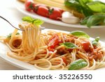 fork with pasta and basil | Shutterstock . vector #35226550