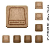 set of carved wooden hard disk...