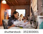 team of designers working at... | Shutterstock . vector #352303001