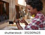 businesswoman looking at smart... | Shutterstock . vector #352309625