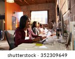 team of designers working at... | Shutterstock . vector #352309649