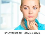 portrait of a thoughtful woman   Shutterstock . vector #352361021