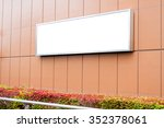 blank billboard on building wall | Shutterstock . vector #352378061