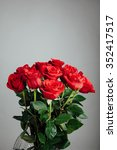 Stock photo rose bouquet on gray background 352417517