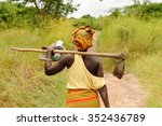 African Woman Going To Work...