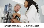 african woman doctor checking... | Shutterstock . vector #352460585