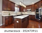 kitchen in upscale home with... | Shutterstock . vector #352473911