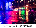 Stock photo rainy night in the big city light from the night club and the windows of the house is reflected in 352474481
