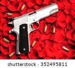 chrome handgun on rose pedals.... | Shutterstock . vector #352495811