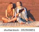 cheerful guy with girl laugh... | Shutterstock . vector #352503851