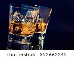 two glasses of whiskey with ice ... | Shutterstock . vector #352662245