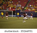 EAST RUTHERFORD NJ - AUGUST 12: Oswaldo Vizcarrondo #6 of Venezuela handles the ball against Colombia during the International Friendly match at Giants Stadium on August 12 2009 in East Rutherford NJ - stock photo