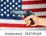a .45 pistol is held in front... | Shutterstock . vector #352729169