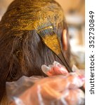 a process of dyeing hair with... | Shutterstock . vector #352730849