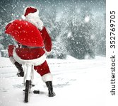 santa claus and bike and sack  | Shutterstock . vector #352769705