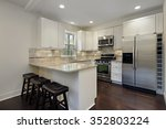 kitchen with white cabinetry... | Shutterstock . vector #352803224