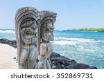 Small photo of Ancient Polynesian style tiki wooden carvings along the beach greet visitors (tourists) to Ki'i Pu'uhonua O Honaunau National Park on the Big Island of Hawaii, an historic travel destination.