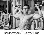 muscular man working out with... | Shutterstock . vector #352928405