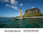 young beautiful girl surfer... | Shutterstock . vector #352929335