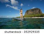 young beautiful girl surfer...   Shutterstock . vector #352929335