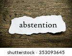 Small photo of Concept message on paper on wooden desk background - abstention