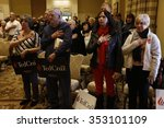 Small photo of LAS VEGAS, NEVADA, DECEMBER 17, 2015: audience for Republican Presidential candidate Sen. Ted Cruz holds hand on for pledge allegiance, R-Texas, Siena Community Ballroom, Las Vegas, NV