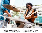 band of musicians playing in... | Shutterstock . vector #353154749