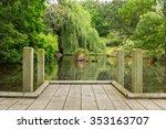 Old Wood Dock In The Garden