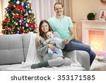 happy family on sofa in the... | Shutterstock . vector #353171585