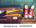 holiday suitcase | Shutterstock . vector #353303591