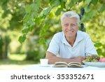 handsome older man sitting at a ...   Shutterstock . vector #353352671