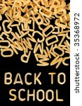 Small photo of Back to school written in kids alphabet soup pasta.