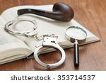 handcuffs  magnifying glass and ... | Shutterstock . vector #353714537
