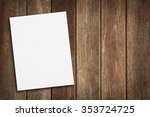 blank paper on wood table | Shutterstock . vector #353724725