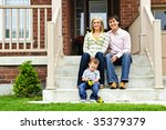 young family sitting on front... | Shutterstock . vector #35379379
