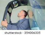 Man Fixing A Bus Mirror