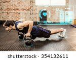 man doing push ups with... | Shutterstock . vector #354132611