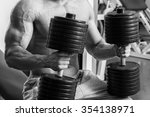 man at the gym. man makes... | Shutterstock . vector #354138971