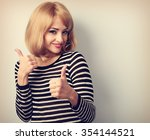 blond happy young woman showing ... | Shutterstock . vector #354144521