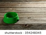 Green Pet Bowl On A Grey Woode...