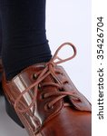 Close-up of a brown polished male shoe. - stock photo