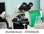 Microscope in busy lab - stock photo