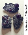Small photo of crystals of Almandine (Garnet) in host rock