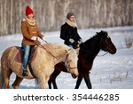 Couple Enjoying Horse Riding I...