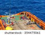 Small photo of Able bodied seamen assisting offshore worker transferring from anchor handling tug to work barge using personal transfer basket